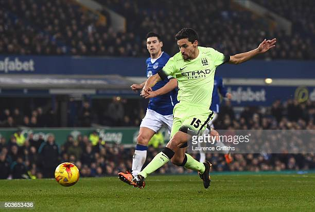 Jesus Navas of Manchester City scores his team's first goal during the Capital One Cup Semi Final First Leg match between Everton and Manchester City...