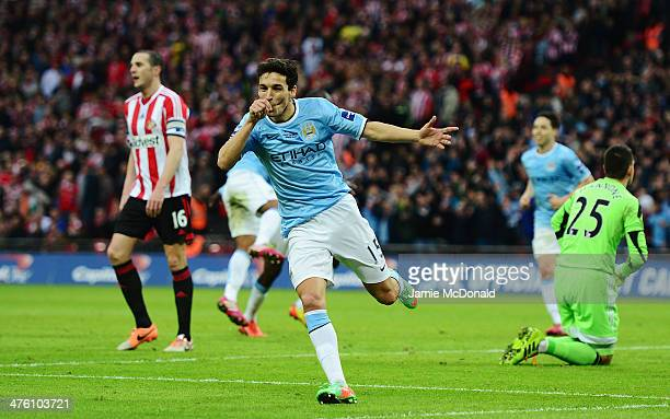 Jesus Navas of Manchester City scores his team's third goal during the Capital One Cup Final between Manchester City and Sunderland at Wembley...