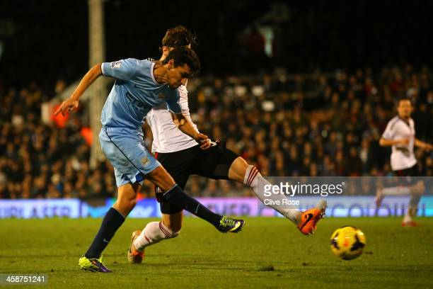 Jesus Navas of Manchester City scores the third goal during the Barclays Premier League match between Fulham and Manchester City at Craven Cottage on...