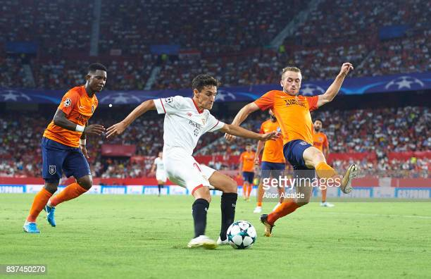 Jesus Navas of Sevilla FC being followed by Edin Visca of Istanbul Basaksehir during the UEFA Champions League Qualifying PlayOffs round second leg...