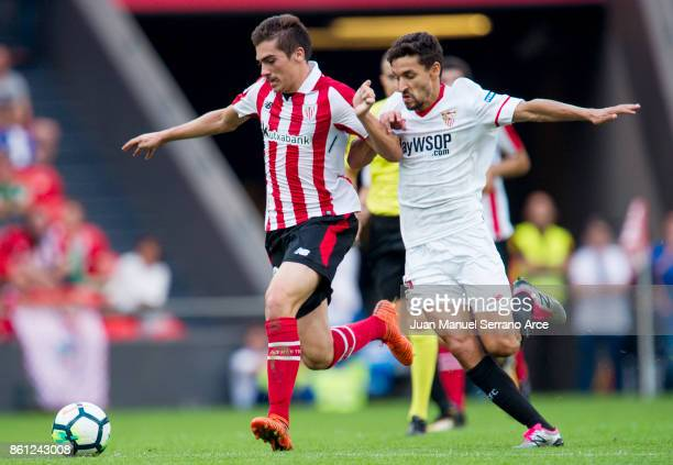 Jesus Navas of Sevilla FC competes for the ball with Inigo Cordoba of Athletic Club during the La Liga match between Athletic Club Bilbao and Sevilla...