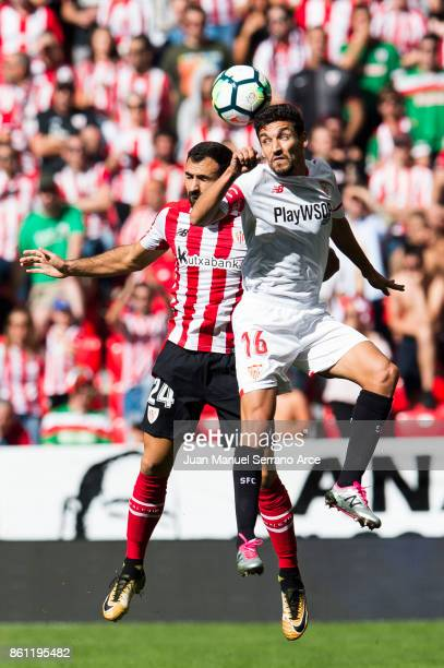 Jesus Navas of Sevilla FC competes for the ball with Mikel Balenziaga of Athletic Club during the La Liga match between Athletic Club Bilbao and...