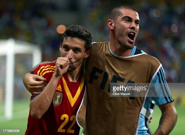 Jesus Navas of Spain celebrates scoring the winning penalty in a shootout with teammate Victor Valdes during the FIFA Confederations Cup Brazil 2013...