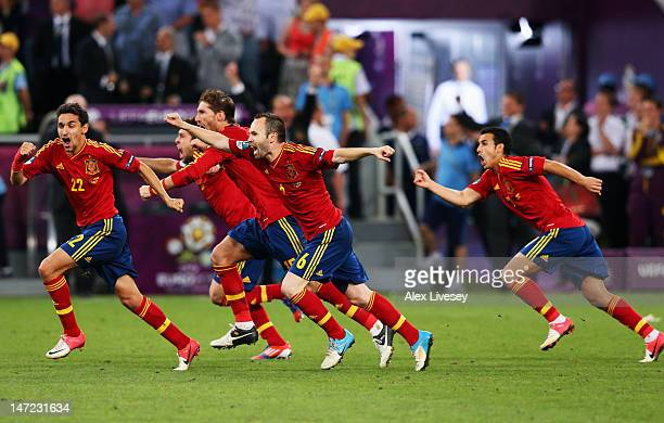 Jesus Navas Sergio Ramos and Andres Iniesta of Spain celebrate the winning penalty during the UEFA EURO 2012 semi final match between Portugal and...