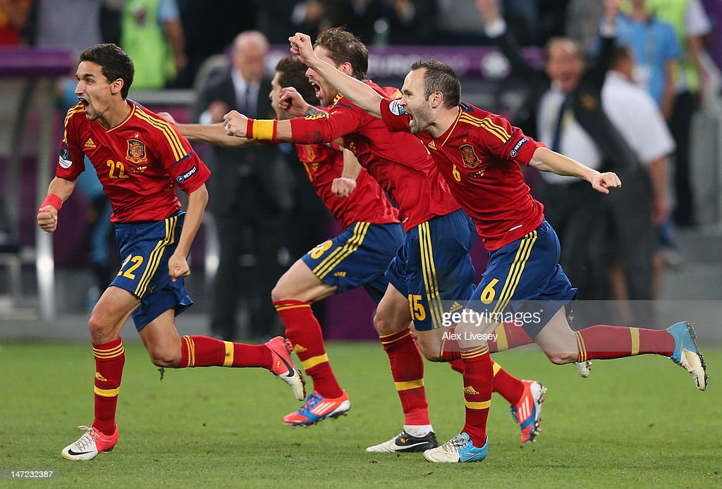 Jesus Navas, Sergio Ramos and <a gi-track='captionPersonalityLinkClicked' href=/galleries/search?phrase=Andres+Iniesta&family=editorial&specificpeople=465707 ng-click='$event.stopPropagation()'>Andres Iniesta</a> of Spain celebrate the winning penalty during the UEFA EURO 2012 semi final match between Portugal and Spain at Donbass Arena on June 27, 2012 in Donetsk, Ukraine.