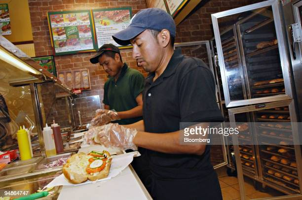 Jesus Olmedo right and Adrian Fermin both Mexican citizens from Oaxaca prepare orders in a Subway restaurant in New York Thursday June 23 2005