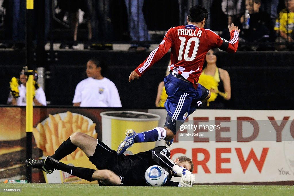 Jesus Padilla #10 of Chivas USA leaps over goalkeeper William Hesmer #1 of the Columbus Crew as Hesmer secures the ball on May 15, 2010 at Crew Stadium in Columbus, Ohio. Columbus defeated Chivas USA