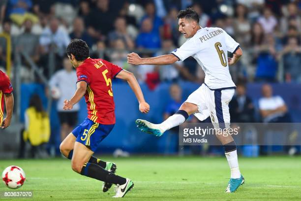 Jesus Vallejo and Lorenzo Pellegrini during the UEFA European Under21 match between Spain and Italy on June 27 2017 in Krakow Poland
