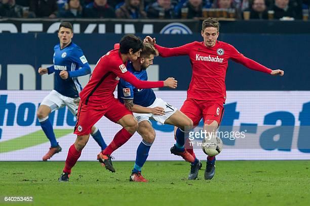 Jesus Vallejo of Eintracht Frankfurt Guido Burgstaller of Schalke and Bastian Oczipka of Eintracht Frankfurt battle for the ball during the...