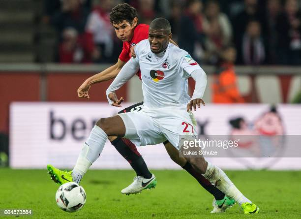 Jesus Vallejo of Frankfurt and Anthony Modeste of Koeln in action during the Bundesliga match between 1 FC Koeln and Eintracht Frankfurt at...