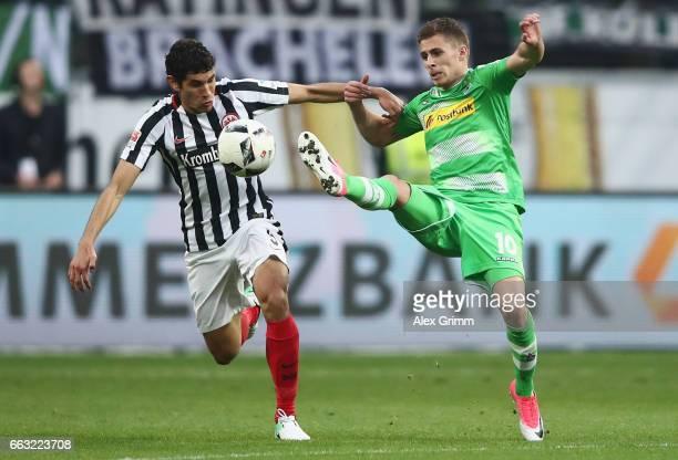 Jesus Vallejo of Frankfurt is challenged by Thorgan Hazard of Moenchengladbach during the Bundesliga match between Eintracht Frankfurt and Borussia...