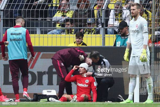 Jesus Vallejo of Frankfurt receives treatment during the Bundesliga match between Borussia Dortmund and Eintracht Frankfurt at Signal Iduna Park on...