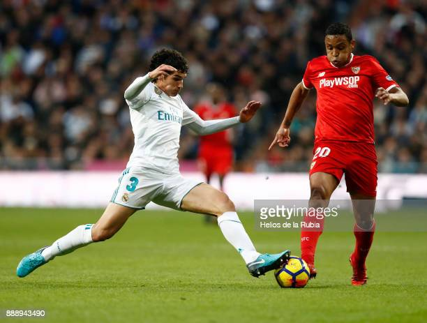 Jesus Vallejo of Real Madrid and Luis Muriel of Sevilla compete for the ball during the La Liga match between Real Madrid and Sevilla at Estadio...