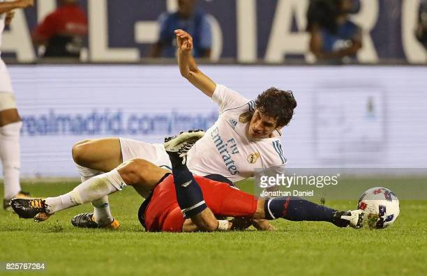 Jesus Vallejo of real Madrid lands on top of Dom Dwyer of the MLS AllStars as they battle for the ball during the 2017 MLS All Star Game at Soldier...
