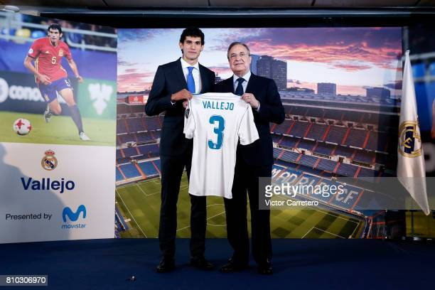 Jesus Vallejo of Real Madrid poses with president Florentino Perez during his official presentation at Estadio Santiago Bernabeu on July 7 2017 in...