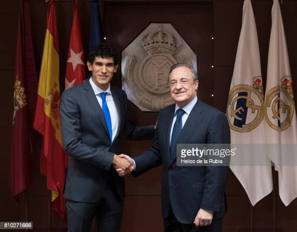 Jesus Vallejo of Real Madrid shakes hands with Real Madrid president Florentino Perez during his official presentation at Estadio Santiago Bernabeu...