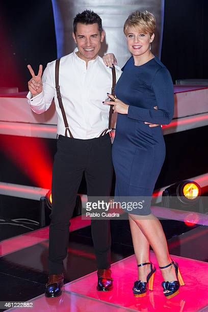 Jesus Vazquez and Tania Llasera pose during a photocall to present the new season of 'La Voz' at 'Picasso' studios on January 9 2015 in Madrid Spain
