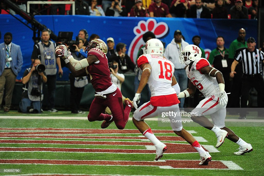Jesus Wilson of the Florida State Seminoles makes a catch for a fourth quarter touchdown against the Houston Cougars during the ChickFilA Peach Bowl...