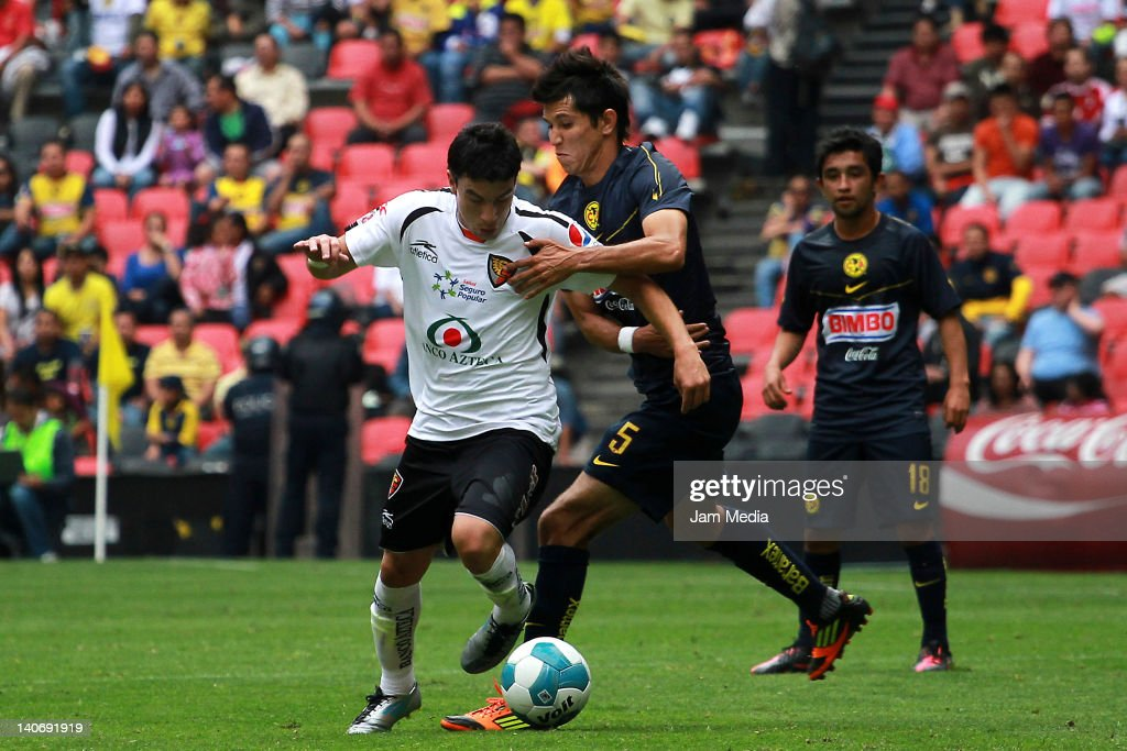 Jesus Zavala of America struggles for the ball with Jorge Rodriguez of Jaguares during a match between America v Jaguares as part of the Clausura...
