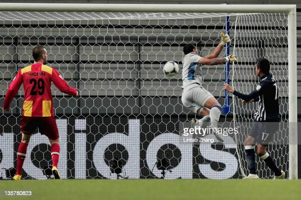 Jesus Zavala of Monterrey heads past goalkeeper Moez Ben Cherifia of Esperance to score his team's third goal during the FIFA Club World Cup 5th...