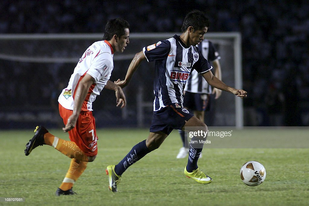 Jesus Zavala (R) of Monterrey struggles for the ball with Oscar Razo (L) of Jaguares during a match as part of the Apertura 2010 at Tecnologico Stadium on August 28, 2010 in Monterrey, Mexico.