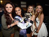 Jesy Nelson Leigh0Anne Pinnock Perrie Edwards and Jade Thirlwall of Little Mix pose with internet celebrity dog Doug the Pug backstage during...