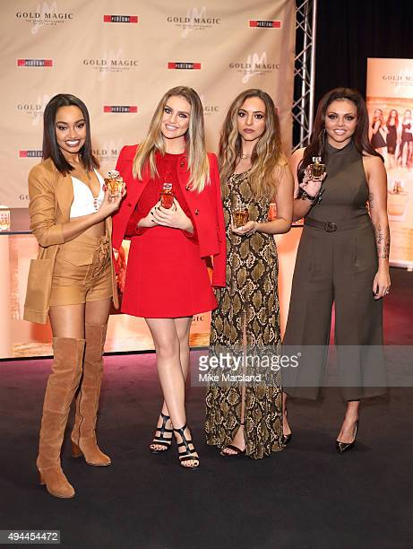 Jesy Nelson Perrie Edwards Jade Thirlwall and LeighAnne Pinnock from Little Mix attend signing for their new fragrance 'Gold Magic' at Bluewater...