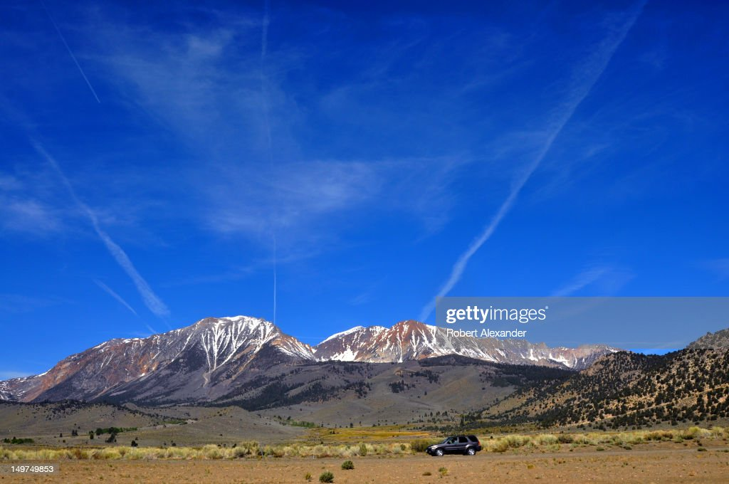 Jet aircraft contrails streak the sky above the Sierra Nevada mountain range near Lee Vining, California. (Photo by Robert Alexander/Archive Photos/Getty Images) 5104602RA_Sierra24.jpg