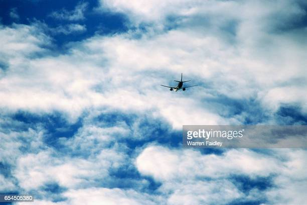Jet Aircraft Flying into Stratocumulus Clouds