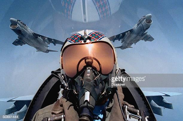 Jet aircraft pilot in cockpit, close-up