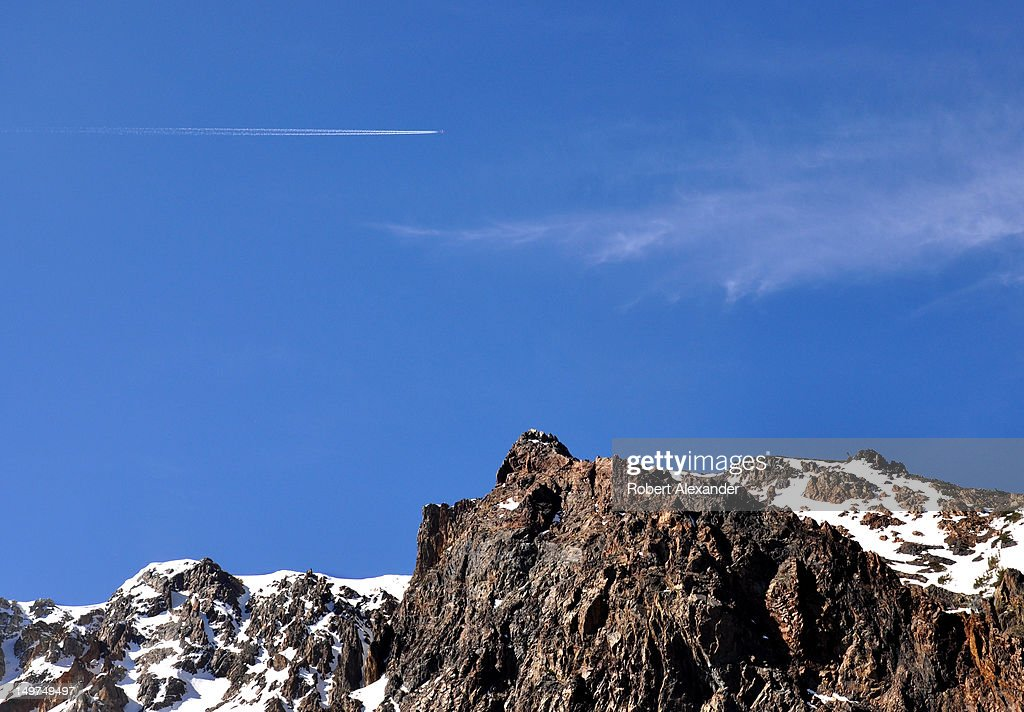 A jet aircraft's contrail streaks the sky above the Sierra Nevada mountain range near Lee Vining, California, and the east entrance to Yosemite National Park. (Photo by Robert Alexander/Archive Photos/Getty Images) 5104602RA_Sierra26.jpg