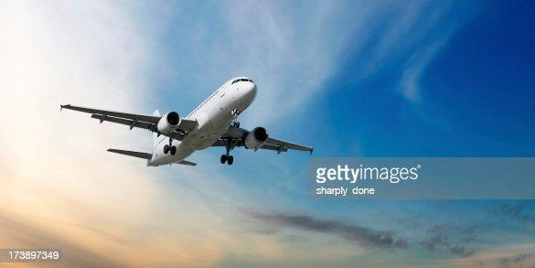 XXL jet airplane landing at dusk