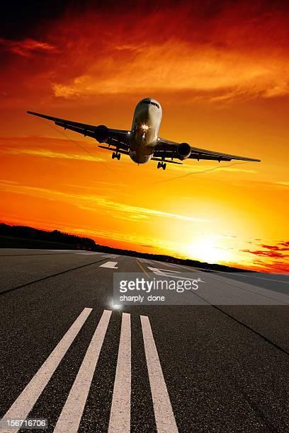 XXL jet airplane landing at sunset