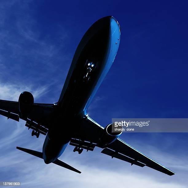 XL jet airplane landing at twilight