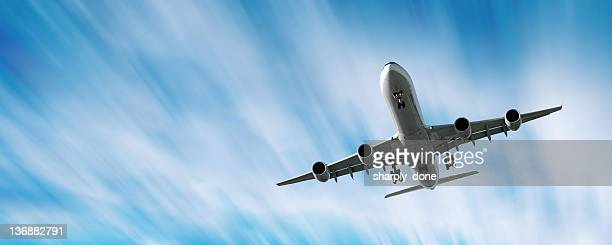 XXL jet airplane landing in motion blur sky