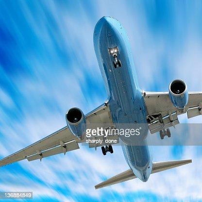 jet airplane landing in motion blur sky