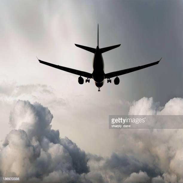 XL jet airplane landing in storm