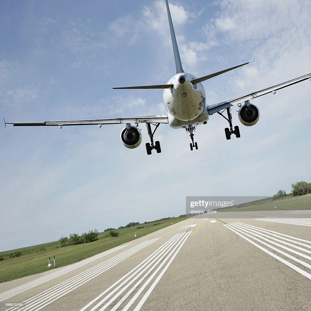 XL jet airplane landing on runway