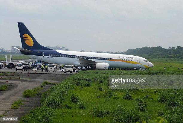 A Jet Airways Boeing 737800 is seen skidded off the runway at the Zia International Airport in Dhaka on August 17 2009 An aircraft bound for Delhi...