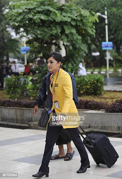 A Jet Airways flight attendant arrives for duty at the city airport in Mumbai on September 13 2009 Services on India's secondlargest private airline...