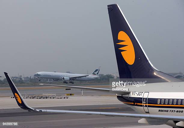Jet Airways jet is seen on the tarmac at Bangkok International Airport following a press conference announcing the inaugural Jet Airways flight from...
