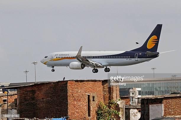 A Jet Airways Ltd aircraft prepares to land at Chhatrapati Shivaji International Airport in Mumbai India on Thursday May 23 2013 Jet Airways India's...