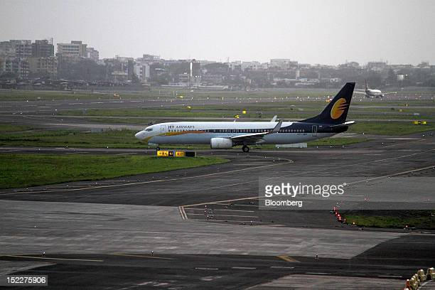 A Jet Airways Ltd aircraft prepares to take off at Chhatrapati Shivaji International Airport in Mumbai India on Monday Sept 17 2012 India's decision...