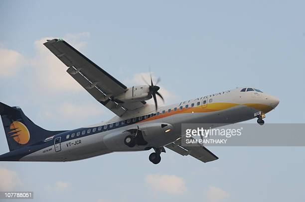 A Jet Airways plane approaches Ahmedabad airport on December 27 2010 Thousands of passengers got stranded as many flights across India got delayed or...