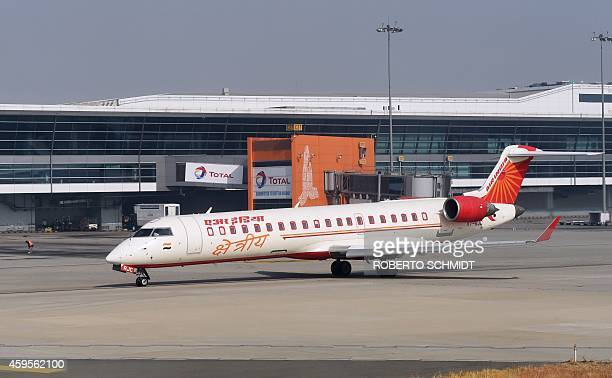 A jet belonging to the Indian carrier Air India rolls past the main terminal of the Indira Gandhi International airport prior to takeoff in New Delhi...
