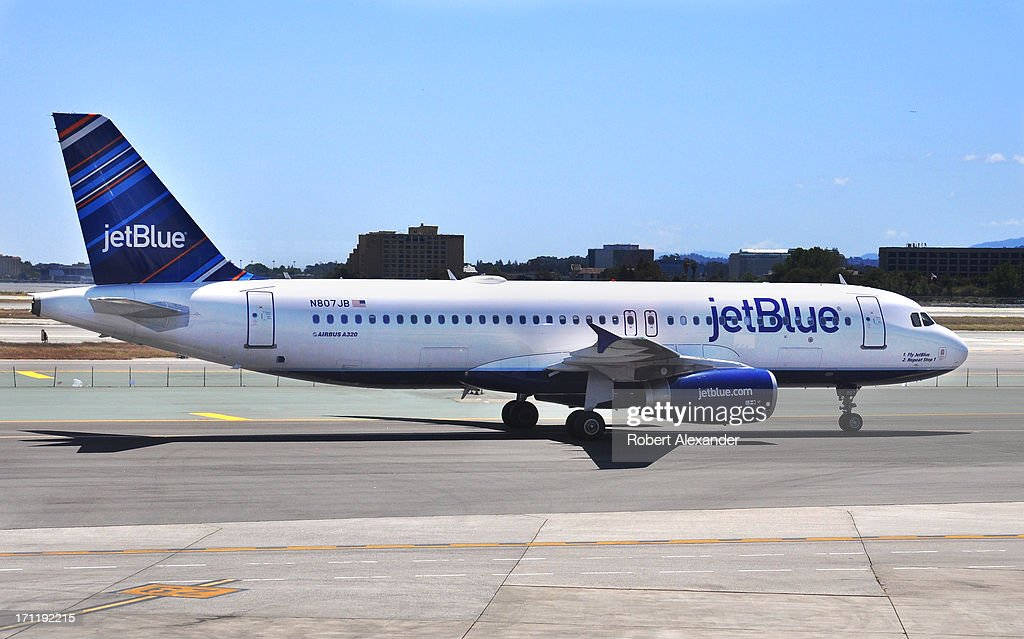 Jet Blue Airbus A320 aircraft taxis on the ramp before taking off from San Francisco International Airport in San Francisco California