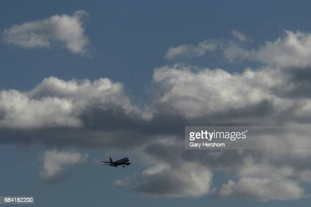 Jet Blue airplane passes through clouds on approach to Newark Liberty Airport on May 15 as seen from Elizabeth New Jersey