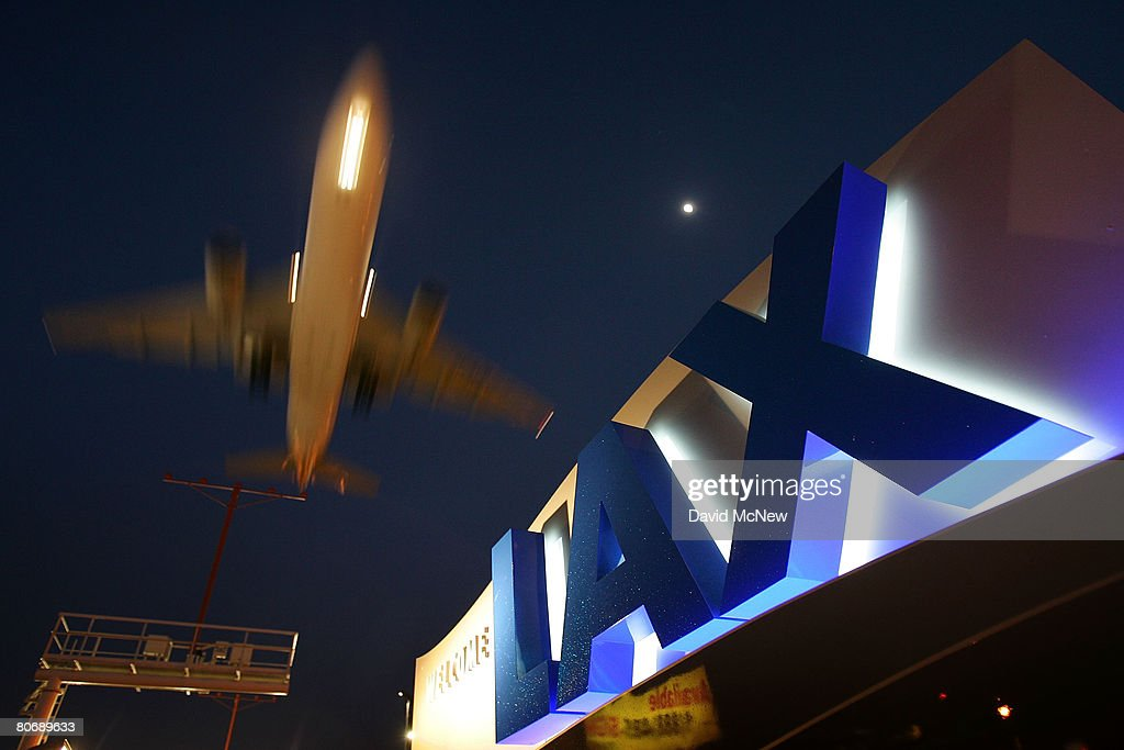 A jet comes in for landing at Los Angeles International Airport (LAX) on April 15, 2008 in Los Angeles, California. With skyrocketing fuel prices and a weak economy, US airlines are turning to mergers which could ultimately lead to higher fares through reduced flights and increased market power. US carriers emerged from a five-year slump in 2006 but with $35 billion in losses. In the latest merger move to save profits, Delta Air Lines Inc will buy Northwest Airlines Corp for more than $3 billion, creating the world's biggest airline. Recent profit challenges to the industry have lead to the shutdown of ATA, Skybus, and Aloha Airlines as well as bankruptcy for Frontier Airlines.