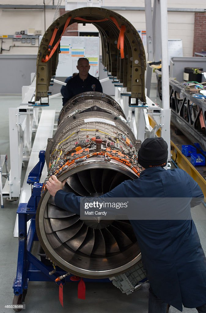 A jet engine is moved underneath a body panel of the Bloodhound SSC vehicle currently taking shape at its design centre in Avonmouth on March 5 2015...