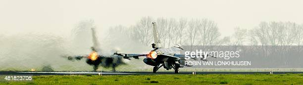 A F16 jet fighter aircraft rolls on the tarmac during the international exercise Frisian Flag 2014 at Leeuwarden Airbase The Netherlands on April 1...